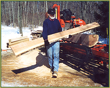 Richard Grell moving lumber at his saw mill